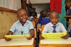 Young school boys enjoying their tablets