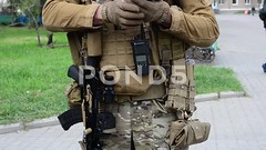 062864685-armed-soldier-exhibition (daria.boteva) Tags: city people army war uniform gun fighter force military helmet band police environmental ukraine illustrative equipment human national camouflage badge terrorists soldiers form aggression guards combat patriotism anti ukrainian armored balaklava balaclava defense troops annexation weapons ato armed heraldic automaticweapon