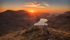 Summit Sundown (Pete Rowbottom, Wigan, UK) Tags: lighting uk trees light sunset england sunlight mountain mountains english water wow evening big still cool flora glow britain lakes lakedistrict warmth style peaceful calm haystacks wainwright cumbria summit sunburst serene colourful cairn goldenhour thelakes buttermere lakedistrictnationalpark goldenlight borrowdale thelakedistrict fleetwithpike northernengland sudown northernlakes uklandscape lakedistrictinteresting peterowbottom nikond750