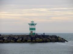 Hangin' Out (Quetzalcoatl002) Tags: sea lighthouse pier fishing harbour scheveningen hangingout seaport breakwater