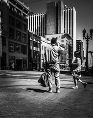 Waiting On The Corner (TMimages PDX) Tags: road street city people urban blackandwhite monochrome buildings portland geotagged photography photo image streetphotography streetscene sidewalk photograph pedestrians pacificnorthwest avenue vignette fineartphotography iphoneography