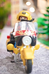 BANGKOK - MAY 1, 2016 : Portrait shot of Playmobil Biker on his motorbike. Adventure and Travel concept. Playmobil belongs to a toy company, the Brandstatter Group, in Germany. Soft Focus. (enchanted.fairy) Tags: