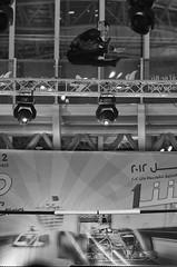 Where's Wally? (ehkxbox) Tags: show bw white black monochrome mall lens asian photography prime bahrain jump nikon shot action spirit f14 air middleeast 85mm xbox f1 exhibition arab acrobat nikkor pinoy seef kix d7000