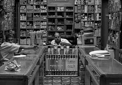 The big boss (B.Jansma) Tags: street boss people bw white man black male shop night work canon dark de 50mm prime hardware store big raw nacht no candid egypt guys scene smoking winkel werken zwart wit baas egypte donker grote streetshot straat zw jongens 500d gereedschap