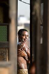 roof top shower in Old Delhi, India (BDphoto1) Tags: poverty portrait india color vertical architecture outdoors shower indian naturallight photograph ethnic cultural hygeine