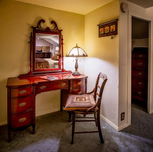 All vintage and antique furnishings. Ever suite has a work desk