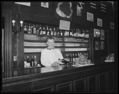 Bartender stationed under shark's jaw (Boston Public Library) Tags: nightlife bartenders lesliejones barrooms
