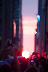 Henge-Worship (A Life of Cyn) Tags: nyc newyorkcity sunset blackberry smartphone manhattanhenge tudorcity hengeworshippers