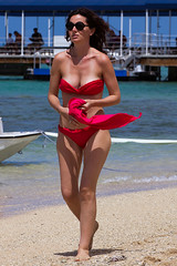 Red Flag (coqrico) Tags: ocean red sea woman usa beach girl sunglasses lady female scarf walking hawaii seaside bright wind waikiki oahu walk duke rico bikini brunette breeze stroll seashore strolling kahanamoku leffanta