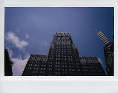 Baltimore Building (ashleycampbell) Tags: sky building film clouds polaroid md fuji maryland baltimore instant fuji210wideformatinstantcam