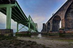 Two Bridges Across the Mersey (Jeffpmcdonald) Tags: uk bridge cheshire runcorn widnes rivermersey silverjubileebridge nikond7000 jeffpmcdonald ethelfledabridge nov2012 flickrstruereflection1 flickrstruereflectionlevel1