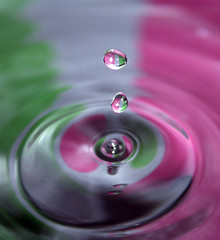 Perrrrlop (Gibbous74) Tags: pink white macro green water reflections vibrant flash drop drip reflected droplet ripples colourful splash waterdrops highspeed plop canoneos1100d