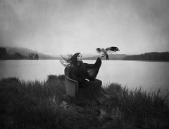 When The Mind Comes Alive (Maren Klemp) Tags: ocean sky blackandwhite woman lake selfportrait painterly bird texture nature water grass canon vintage hair outdoors movement chair horizon dream surreal windy hills expressive nostalgic dreamy conceptual fineartphotography darkart blackandwhitephotography melancholia evocative fineartphotographer darkartphotography