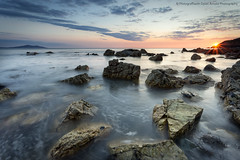 Gola' 'Ola ym Mhorth Swtan / Last Light at Church Bay (Ffotograffiaeth Dylan Arnold Photography) Tags: longexposure sunset sky sun seascape clouds movement rocks waves colours horizon wideangle hues coastline goldenhour ynysmon anglesey churchbay holyheadmountain porthswtan