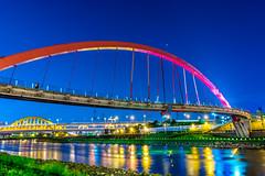 Raibow Bridge Taipei (hamzaqayyum) Tags: city bridge blue water reflections river lights rainbow nikon steel taiwan sigma structure hour 1750 taipei keelung d5200