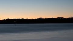 Daybreak at the waterfront (Merrillie) Tags: longexposure sea seascape nature water sunrise landscape outdoors photography dawn bay nikon scenery daybreak waterscape d5500