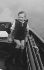 Health & Safety were here (theirhistory) Tags: boy child kid boat rowing shorts wellies oars lifejacket pond shirt lake rubberboots water yacht