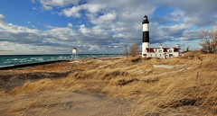 Big Sable Point lighthouse -  Ludington, Michigan (Michigan Nut) Tags: sky beach clouds geotagged midwest michigan landmark lakemichigan johnmccormick bigsablepointlighthouse michigannutphotography