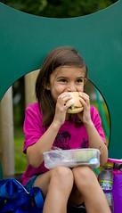 Sadie #1 (The_Kevster) Tags: leica portrait london girl playground lunch person bap rangefinder sandwich pear bite lunchbox eastlondon isleofdogs summicron50mm millwallpark leicam9