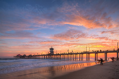 huntington beach surfers (Eric 5D Mark III) Tags: ocean california light sunset sky people usa cloud seascape painterly color beach canon landscape pier unitedstates surfer wave atmosphere wideangle gradient orangecounty huntingtonbeach tone tiltshift tse17mmf4l eos5dmarkiii 5d3