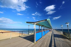 Boscombe Pier (Mike Dorey) Tags: light shadow sea england sky sun english water lines architecture clouds landscape coast pier seaside sand nikon angle britain south sigma bluesky coastal shade coastline bournemouth brittish d90 englishness