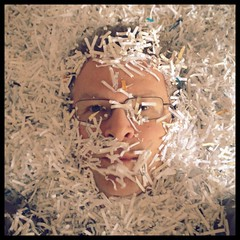 Me after quite some document shredding (schermpeter42) Tags: portrait selfportrait male me self paper square glasses strips magichour shredded meself birdsview iphone shreddedpaper project365 project356 meself365