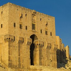 Aleppo Citadel, Syria (Eric Lafforgue) Tags: color colour history rock architecture square outdoors photography ancient day fort citadel medieval syria ottoman protection fortress thepast aleppo siria 285 levant syrien syrie sirja traveldestinations colorimage suriye   syri buildingexterior fortifiedwall  aleppocitadel sria szria  westernasia    suriah sirija  cp  sora