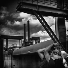 Urban Love - Columns (Collin Key) Tags: urban bw man germany outdoors togetherness women kiss couple industrial contemporaryart hamburg michelle youngadult lowkey deu elbe caucasian bjarne imagepoetry lunaphoto floodbarrage stealingshadows collinkey