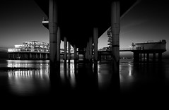 Scheveningen Pier (Haags Uitburo) Tags: lighting sea bw white black holland building beach water netherlands dutch architecture night strand speed lights la pier blackwhite jump meer europa europe long exposure slow zwartwit scheveningen centre den north nederland silk noordzee zee denhaag hague promenade shutter architektur bungy avond haag schwarzweiss effect zwart wit weiss paysbas nederlands thehague schwarz haye laia olanda piles architectuur avondlicht haya niederlande schemering kust lange the haagse sluitertijd vandervalk haags scheveningse haia a uitburo uitbureau haagsuitburo