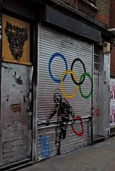 Stealing Red in Redchurch Street (richwat2011) Tags: urban streetart london silver graffiti nikon mural cityscape shoreditch d200 e1 londonstreets eastlondon redchurchstreet towerhamlets olympiclogo 18200mmvr