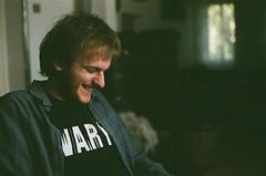 smiles. (madhjamaka) Tags: blue light boy fall smile analog indoor agfavista200 pentaxsupera skritek