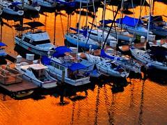 Fond sunset memories of Hawaii (peggyhr) Tags: blue sunset orange closeup marina hawaii sailboats thegalaxy peggyhr thegalaxyhalloffame frameit~level01~ frameit~level02~ morgenrotundabendrot