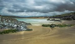 Crantock Bay (jebob) Tags: light england sky seaweed texture water clouds coast sand rocks cornwall shine cliffs tidal
