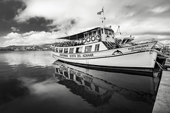Boat At The Dock (BoXed_FisH) Tags: travel blackandwhite bw white black reflection water valencia monochrome grey mono boat seaside spain europe ship cloudy sony wideangle monotone espana es pescola peniscola comunidadvalenciana fishingtown sonyalpha sonyzeiss zeiss1635 sonya7 sel1635z sony1635mmvariotessartfef4zaoss sonyzeiss1635f4oss