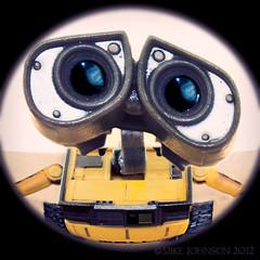 Is there anybody out there... (spatialpan) Tags: colour eye yellow photoshop lens toy robot interestingness hole disney fisheye plastic pixar spy plugin whatever peep peephole nationalgeographic distort eyespy onblack walle mikejohnson photomatix canon450d pixelbender spatialpan