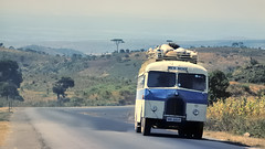 Crawling up from the Rift Valley - near Iringa, Tanzania, 1977 (edk7) Tags: africa bus rural landscape tanzania countryside highway near slide luggage nikkormat riftvalley iringa ft2 197707 edk7 af130