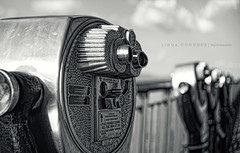 Take a look... (Linda Goodhue) Tags: blackandwhite contrast machine binoculars riverfront quarters viewers windsorontariocanada toweropticalcompany lindagoodhuephotography