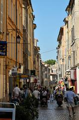 Aix-en-Provence (MikePScott) Tags: camera france sign shop buildings logo lens streetlight streetlamp flag banner aixenprovence lamppost provence builtenvironment architecturalfeatures provencealpescôtedazur nikond300 featureslandmarks nikon70300mmf3556vr