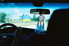 ON THE ROAD (lauren s_) Tags: ford film car truck mirror highway clare driving kodak iso400 michigan feathers roadtrip rearviewmirror freeway vehicle upnorth steeringwheel dreamcatcher us127n