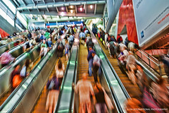 New York in the Eyes of the Newcomer (TIA International Photography) Tags: world new york city nyc travel light people ny motion blur men tourism up station sign stairs speed port tia underground subway video insane blurry women downtown ray chaos traffic path manhattan madonna authority crowd escalator transport center tourist billboard passengers advertisement busy rush transportation commute pedestrians metropolis wtc dizzy velocity adults trade ascension tosin ascend chaotic resident arasi transhudson tiascapes tiainternationalphotography