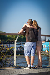 Riverside embrace 2 (jrmsctt) Tags: people woman white man black color colour london thames portraits river view greenwich couples desire olympics canarywharf gmt london2012 expressyourself streetportraiture streettogs