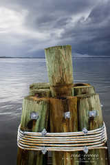 Bracing for the Storm (Vena-Yvonne) Tags: ocean travel vacation gulfofmexico water port docks bay gulf rusty destination inlet thunderstorm pilings ropes nautical panamacity seasalt