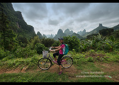 Bicycling amidst the towering limestone karst mountains near Yangshuo, Guangxi Autonomous Region, China (jitenshaman) Tags: china travel wild mountains green nature bicycle forest landscape asian liriver li scenery asia ride guilin yangshuo chinese adventure jungle limestone destination verdant peaks karst pedal guangxi xingping worldlocations