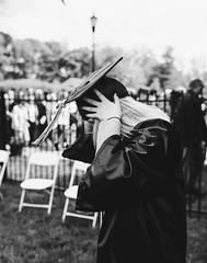the cap (almostsummersky) Tags: portrait college philadelphia girl hair us blackwhite spring hands university unitedstates pennsylvania sister graduation monochromatic cap blonde graduate gown manayunk tassel adjust saintjosephsuniversity