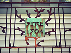 Since 1904 (V and the Bats) Tags: texture floral sign metal iron number greenhouse 1904 since1904 experimentswithtexturecolorandlight