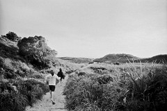 Dunes (scott.little.images) Tags: summer bw film beach boys 50mm candid dunes fomapan id11 nikkormatel