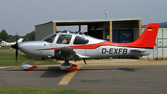 D-EXFB CIRRUS SR22T (BIKEPILOT) Tags: uk greatbritain red silver flying airport aircraft aviation hampshire aeroplane german cirrus airfield aerodrome blackbushe sr22t dexfb