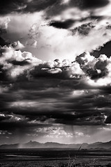 Thunderstorm over Baboquivari (Gautham Narayan) Tags: arizona blackandwhite mountain storm clouds landscape tucson az baboquivari thunderstorm arizonasonoradesertmuseum visittucson