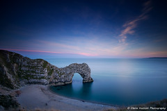 (Claire Hutton) Tags: uk longexposure blue sunset sea cliff water rock night dark landscape coast smooth le dorset durdledoor ndfilter jurassiccoast 10stopper