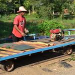 Man Preparing Bamboo Train for Departure 2 thumbnail